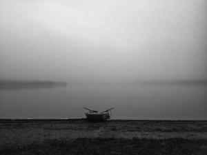 Boat next to foggy sea